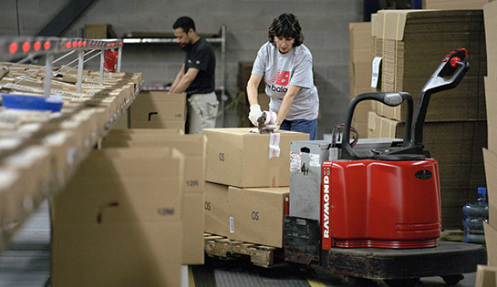 Raymond pallet jack, conveyor system and operators at New Balance distribution center