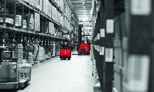 Raymond Courier Automated Pallet Truck in warehouse aisle
